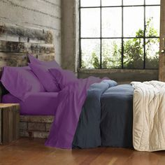 {wood + brick bed frame!} also, purple sheets :)