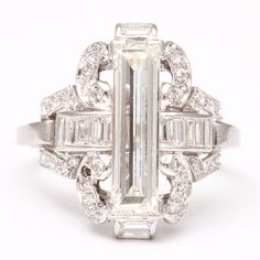 Unknown designer 1925. Platinum diamond art deco ring. Very rare long emerald cut. *vintage leavers*