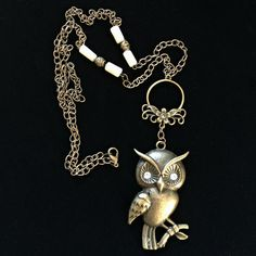 """Meet """"Henry."""" Henry is an Antique Bronze Owl Necklace, adorned on a 29"""" antique brass cable chain, accented with natural colored, long glass beads and round antique brass beads, with a lobster claw clasp, by essensu."""