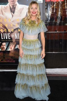 Miller wore a tiered Gucci dress and her hair in her signature boho waves for the [i]Live By Night[/i] premiere in Los Angeles.