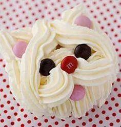 Cupcake formando la cara de un perro