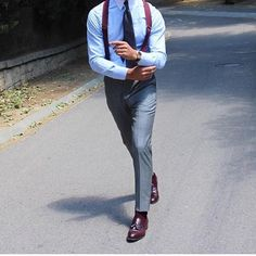 I like the wine color with the grey suit. the shoes really pull it together.