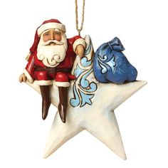 4047799 Santa On Star Hanging Ornament- This celestial Santa with his bag full of toys takes a break from his journeys on the point of a star. It is a whimsical folk-art scene crafted with the heartfelt style that is unmistakably Jim Shore #jimshore #enesco #festive