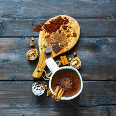 #Mug of hot chocolate  Mug of freshly made rich winter hot chocolate with cinnamon sticks and ingredients on wooden background top view. Square image