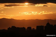 The sun sets resulting in a sublime golden skyline in Beijing, capital of the People's Republic of China.
