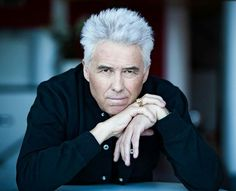George Kooijmans (March 11, 1948) Dutch singer, composer, guitarist, poet and producer, known from the band The Golden Earring.