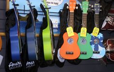 These are fun ukes from Amahi.  The Amahi ukulele folks call these Penguins and Ducks, appropriate names, since they're cute and safe around the water.    They start around $39, and make great gifts for tykes, as well as for college students who want a uke they can drag along to parties or the pool. These come in a lot of colors and designs, and are all strung with the traditional high-G ukuelele strings.   Backstage Music, 115 Highway 12 West, Starkville, MS  662-323-3824