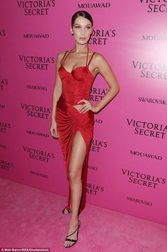 Red-hot! The brunette bombshell, who wowed in an array of silk and semi-sheer negligee before taking to the runway in the designer's coveted wings before posing after the party