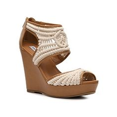 Steve Madden Shera Wedge Sandal/ Madden knows how to compliment a great sundress for the summer with these great sandals.