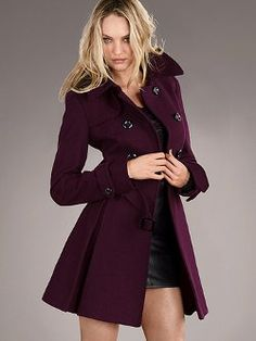 The epitome of chic: the Wool Double-breasted Trench Coat from Victoria's Secret. Tailored with ultra-feminine details: a waist-cinching belt for an hourglass shape and a swingy, pleated hem. Front pockets keep hands warm and essentials close.