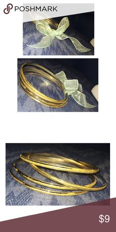 Gold Glitter Bengal Bracelets 4 gold bengal bracelets with golden glitter round it! Although, some of the glitter has worn off—only a little (see above). Even if you took the glitter off, it will still look stunning!  NO RUST! Jewelry Bracelets