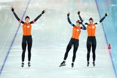 Jorien ter Mors, Ireen Wust and Marrit Leenstra of the Netherlands celebrate winning the gold medal during the Women's Team Pursuit Final A Speed Skating event (c) Getty Images