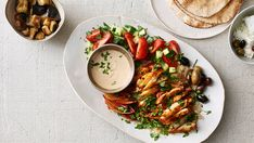 Oven-Roasted Chicken Shawarma - Here is a recipe for an oven-roasted version of the classic street-side flavor bomb usually cooked on a rotisserie. It is perfect for an evening with family and friends. (Photo: Johnny Miller for The New York Times) Shawarma Recipe, Oven Roasted Chicken, Oven Chicken, Roasted Cauliflower, Baked Chicken, Cooking Recipes, Healthy Recipes, Nytimes Recipes, Yogurt Recipes