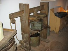 A wooden press.  I've seen a version of this press in use at Bunten Farmhouse Creamery in Orford, NH.