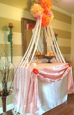 BABY SHOWER. Girl baby shower. Party. Decorations. Pom Poms. party ideas. Drape tablecloth. Orange. Pink. Coral. Brown. White. Stripes. Wall Stripes.