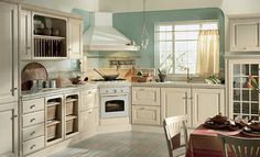 Scavolini Baltimora kitchen with range in corner.