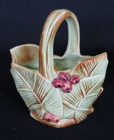 Beautiful 1940s McCoy pottery basket featuring green leaves and bright berries.