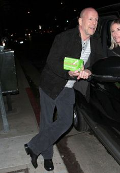 Bruce Willis was spotted chatting with the new Real Housewives of New York City star Kristen Taekman. What's in his hand? The Berry Melon Shot of EBOOST!