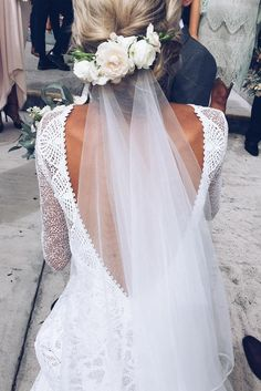 WOW I love this long wedding veil and floral hairpiece! This is such a cute hairstyle, and that lace dress is stunning.