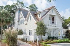 """Empty Nesters Florida Vacation Home  shingles are stained in an acrylic paint color – """"Repose Gray by Sherwin Williams"""".  side shutters are painted in """"Benjamin Moore Sea Pines"""" Exterior trim and garage doors paint color is """"Benjamin Moore OC-117 Simply White""""."""