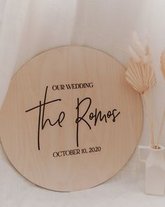 "Last Name Wedding Signage - Engraved on 1/4"" Natural Baltic Birch wood. Description: Natural and classic way of welcoming your guests. Can be used as signage or even a wedding guestbook. Laser Engraved on Natural Wood for a classic look. Available in the following sizes: 14"" diameter 18"" diameter - shown 24"" diameter 26"" diameter Background: Natural Wood Lettering: Engraved Materials used: 1/4"" Natural Birch laser cut. Due to nature of design, no hanging hardware is included. We recommend mounti"