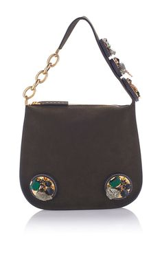 This **Marni** shoulder bag is rendered in leather and features an adjustable shoulder strap with embellishments and chain detailing.