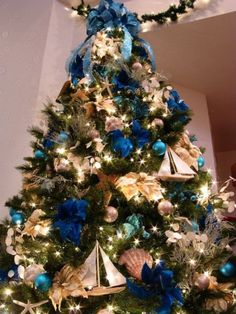 Unique Blue and silver Christmas Tree Decor Ideas. A beautiful Christmas tree can awaken the Christmas spirit of everyone who sees it. Make sure your Christmas tree looks charming and classic with … Coastal Christmas Decor, Nautical Christmas, Gold Christmas Decorations, Christmas Tree Themes, Silver Christmas, Noel Christmas, Holiday Tree, Beach Christmas, Coastal Decor