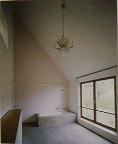 House in Leymen, France, 1997 - Herzog & de Meuron.  The spartan interior - this is the bathroom.  Note the chandelier against the concrete interior.