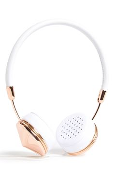 Trendy rose gold and white headphones for the music lover.