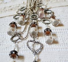 messages in bottles ~Me- so cute! Looks like it should be hung from the ceiling in a baby girls room.