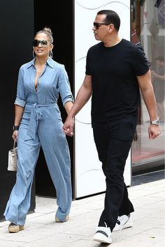 8742a49b6 Jennifer Lopez looks ready for spring in a denim jumpsuit during an outing  with Alex Rodriguez