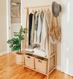 """""""This little clothing rack is one of my favorite purchases ever. We have a ver. """"This little clothing rack is one of my favorite purchases ever. We have a very small closet, so keeping this rack in my bedroom gives me… Space Saving Bedroom, Space Saving Furniture, Space Saving Storage, Small Closets, Open Closets, Dream Closets, Master Bedroom Closet, Minimalist Wardrobe, Simple Wardrobe"""