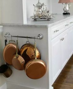 Even if you don't have fancy cookware to display, this will still be an awesome organization trick. Again, I say win-win. Oh, and keep the bottoms of your (stainless or enameled) pans looking spankin' new with Bar Keepers Friend and a bit of elbow grease. See this kitchen here.