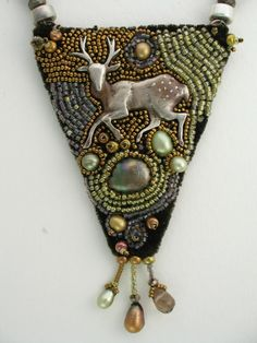 Bead-embroidered necklace. Sterling silver deer with pearls, and vintage glass beads