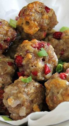 These cheddar sausage bites stuffed with fresh cranberries are a perfect seasonal appetizer, game day snack or even as dinner!
