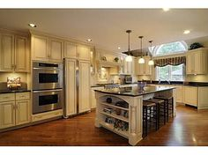 I love this French Country feeling kitchen