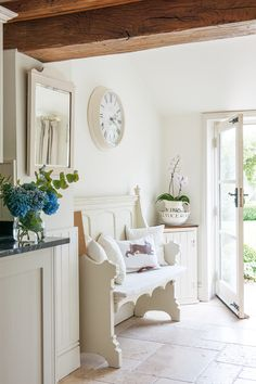 Entrance to breakfast room in country cottage. White pew, tongue and groove panelling and the jug and bowl combo all give a fresh country look. If you like this pin, why not head on over to get similar inspiration and join our FREE home design resource library at http://www.TheHomeDesignSchool.com/signup ?