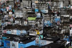 PHILIPPINES: A boy leaping between apartment-style tombs in the Barangka public cemetery as Filipinos visit the graves of their deceased loved ones to commemorate All Saints Day. REUTERS/Czar Dancel