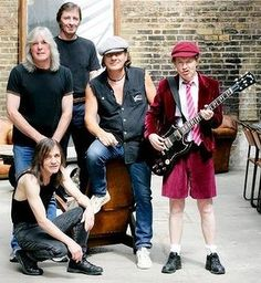 AC/DC, with Malcolm Young at lower left.  Has dementia
