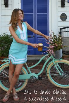 This Sail to Sable classic sleeveless dress is to die for. Paired perfectly with a pair of Jacks and a bicycle full of flowers. <3