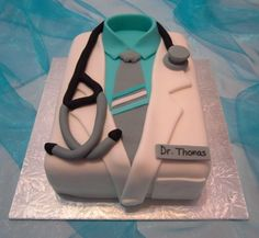 "Doctor's coat  - This cake was made for a thank you gift. It was a carrot cake with a pecan caramel filling, covered in fondant. It was an 8"" x 6"" rectangle."