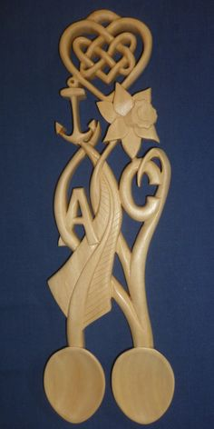 New Zealand fern and Welsh Daffodil love spoon with Celtic knot and double bowls.  www.adamking.co.uk
