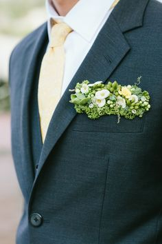 Floral pocket squares are a modern alternative to the traditional groom's boutonniere and look fab!