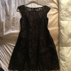 👻SALE! Nanette LEPORE gorgeous lace LBD NWOT, 4 GORGEOUS fit and flare style, above the knee black and brown dress. Upper chest, back and sleeves are not lined. Lace only. Size 4. Never been worn. New without tags.  Perfect for any occasion. Nanette Lepore Dresses Prom