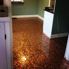 #pennyfloor #diy #flooring This is my new kitchen floor!!!! I love my penny floor!!! 41,292 pennies, two tubs of premixed thinset, 1 bag of white nonsanded grout, and one gallon of garage floor clear epoxy with non slip additive! Oh and threeeeee looooong weeks!!!! Penny tile floor!