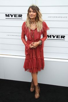 Paris Jackson in red ruffle dress and tan ankle boots