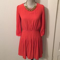Kimchi Blue sexy dress in coral/red orange. Already dry cleaned and in perfect condition. Ready for a night out and the back is sexy. From Urban Outfitters. Used once for engagement party. Urban Outfitters Dresses