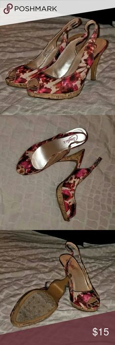 Pink Abstract Print Sling Back Heels This is an awesome pair of Candies heels.  Classic shoe with a unique print and cork heel and platform that never goes out of style.  Approx 4 inch cork  heel and 1/2 inch cork platform.  Great for a professional work environment or a casual gathering with friends.  Worn only 2 or 3 times. Candie's Shoes Heels