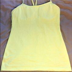 Lululemon take top in a soft yellow green Light yellow/green color. Built in bra. Lululemon lululemon athletica Tops Tank Tops