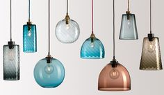 Range of colourful pendant lights on a neutral background